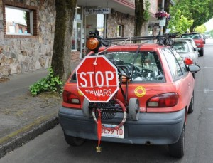 Funny car with stop the war sign