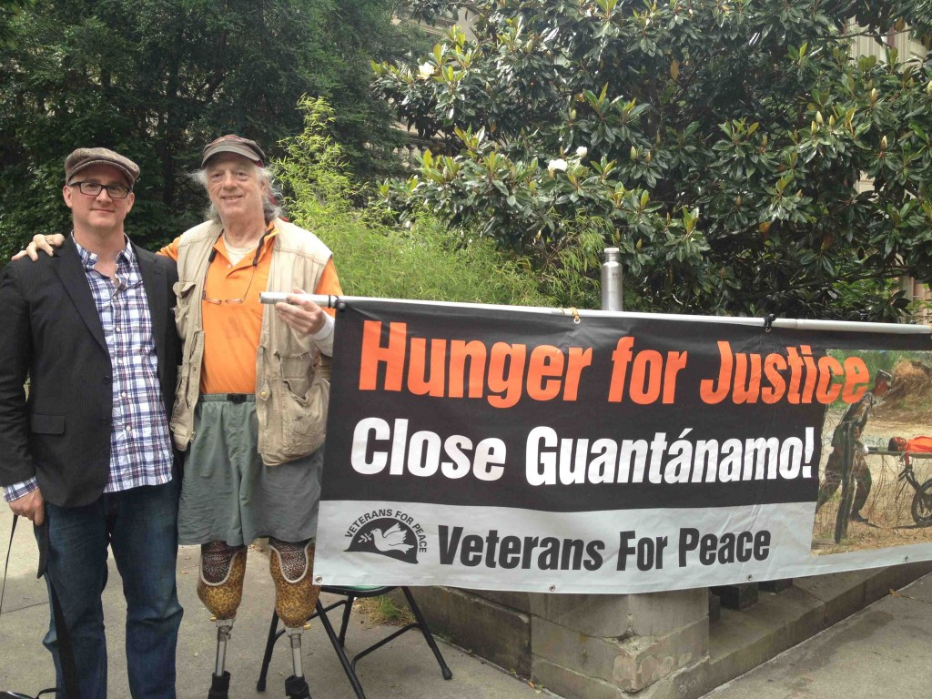 "Brian with ""Hunger for Justice"" banner"